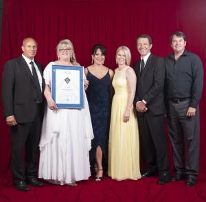 The award winning team at Devrite, receiving custom home building award.